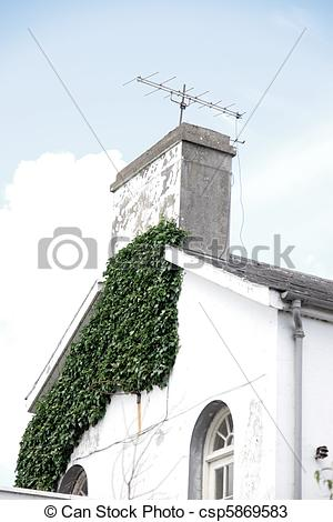 Stock Photos of rustic gable end of building with ivy.