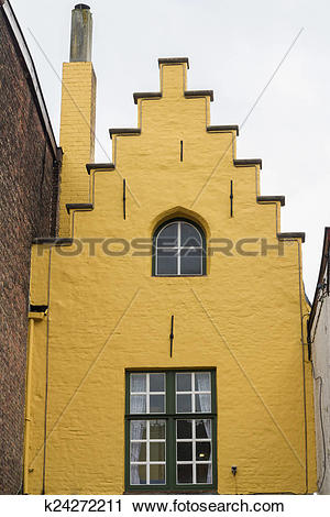 Stock Photography of Bruges, yellow gable end of old town house.