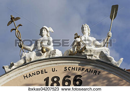 Stock Photo of Gable figures, shipping and trading, with anchor.
