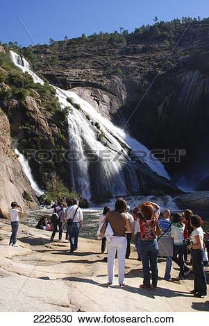 Stock Photography of Tourists at waterfall, Xallas River, Ezarok.