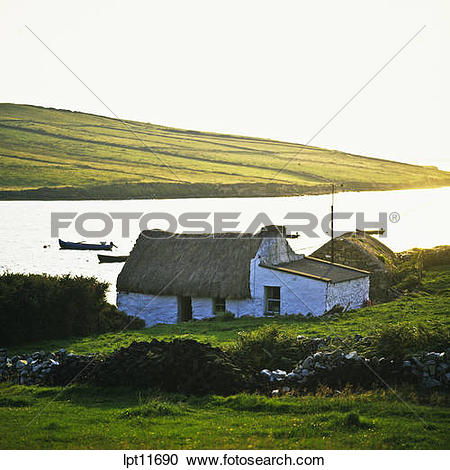 Stock Photography of THATCHED COTTAGE CLIFDEN BAY CONNEMARA COUNTY.