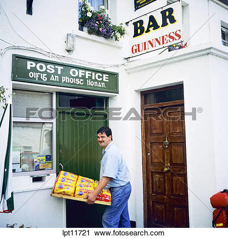 Stock Photography of MAN DELIVERING TO POST OFFICE LEENANE.