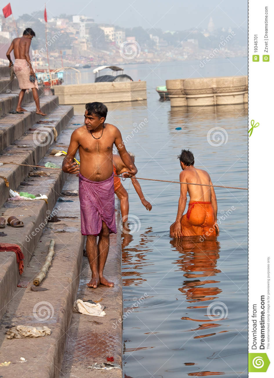 Hindu Pilgrims After Bathing In The Ganges River Editorial Photo.