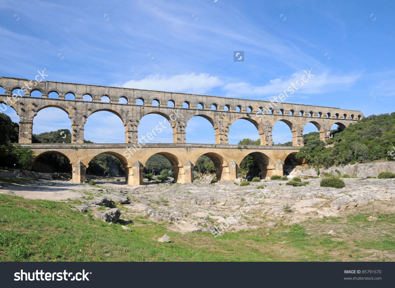 Ancient Roman Aqueduct Bridge Pont Du Gard Over Gard River Near.