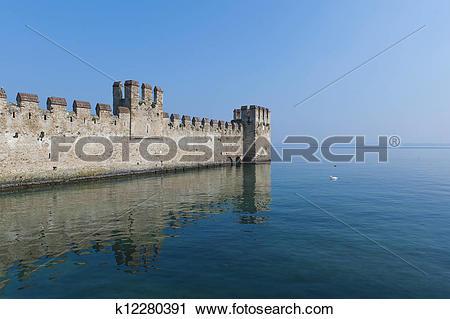 Clipart of Medieval Castle on Lake Garda k12280391.