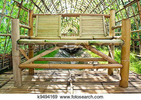 Stock Photograph of Chair made from bamboo in garden architecture.