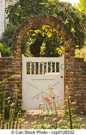 Stock Photo of garden gate with brick archway,white gate.
