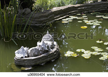 Stock Photo of GARDENS: 1930'S Arts and crafts garden with pond.