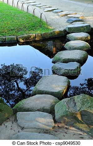 Stock Photography of Stepping stones crossing water in the.