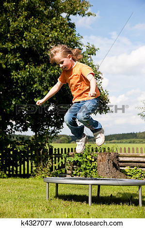 Picture of Girl child on trampoline in the garden k4327077.