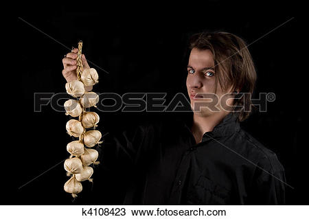 Stock Photo of Vampire doesn?t like the smell of garlic k4108423.