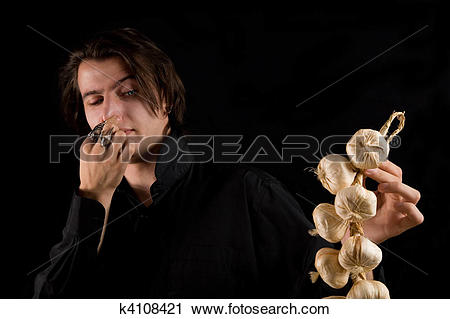 Stock Photography of Aristocratic vampire doesn?t like the smell.