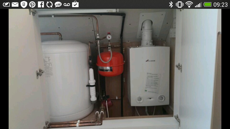 Gas Boiler and 2 unvented hot water cylinders in loft conversion.