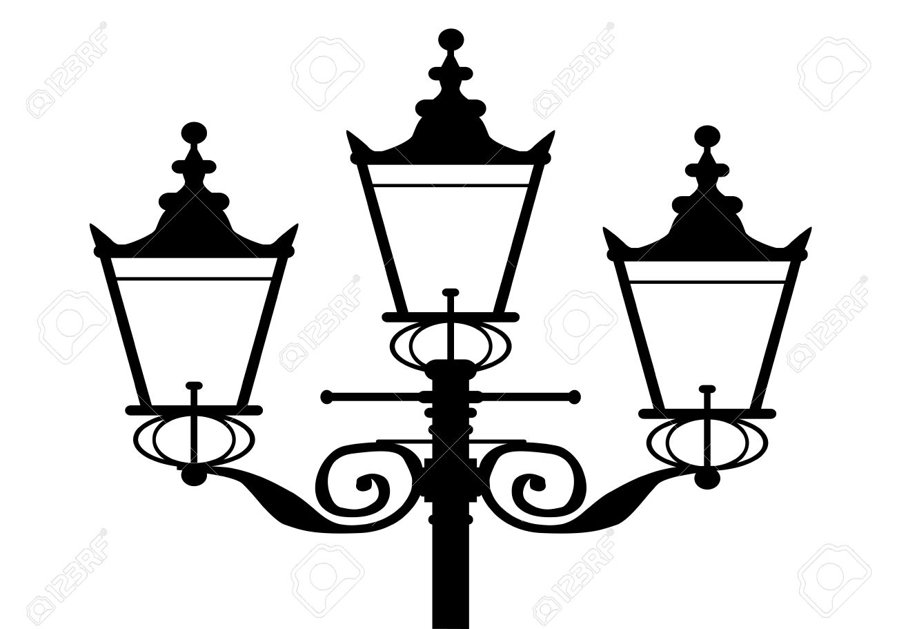 A Typical Old London Gas Street Light In Silhouette Royalty Free.