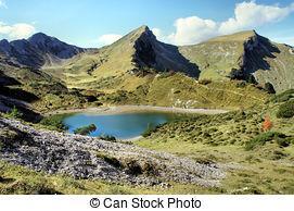 Stock Photo of Mountain lake and Tannheim Mountain.