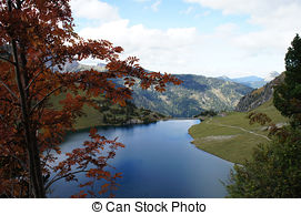Stock Photo of Mountain lake and Tannheim Mountain.