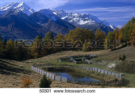 Stock Photography of Pond in front of mountains, Dolomites, Etsch.