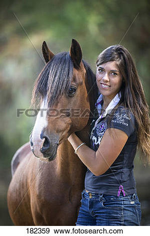 Stock Photograph of Kaimanawa Horse. Kelly Wilson with a bay.