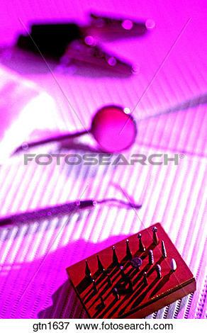 Picture of Purple gelled image of dental tools. gtn1637.