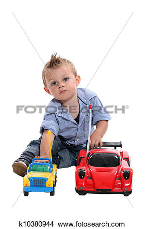Stock Photo of Tot with gelled hair playing with toy cars.