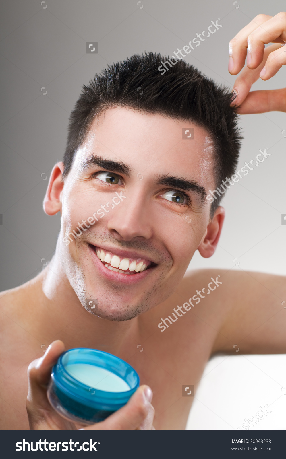 Young Handsome Man Applying Hair Gel Stock Photo 30993238.