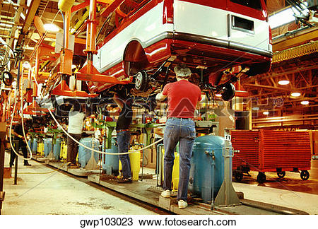 Stock Photo of Workers working in a plant, General Motors Plant.