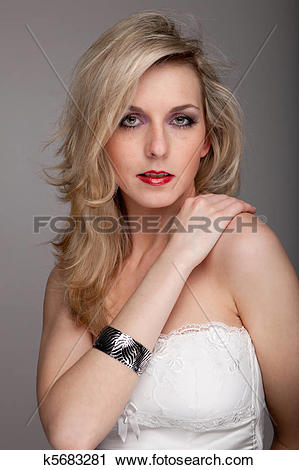Stock Photography of A German woman with long blond hair turns her.