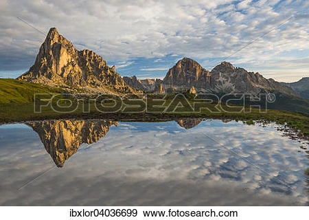 "Stock Photograph of ""Gusela mountain at sunrise reflected in small."