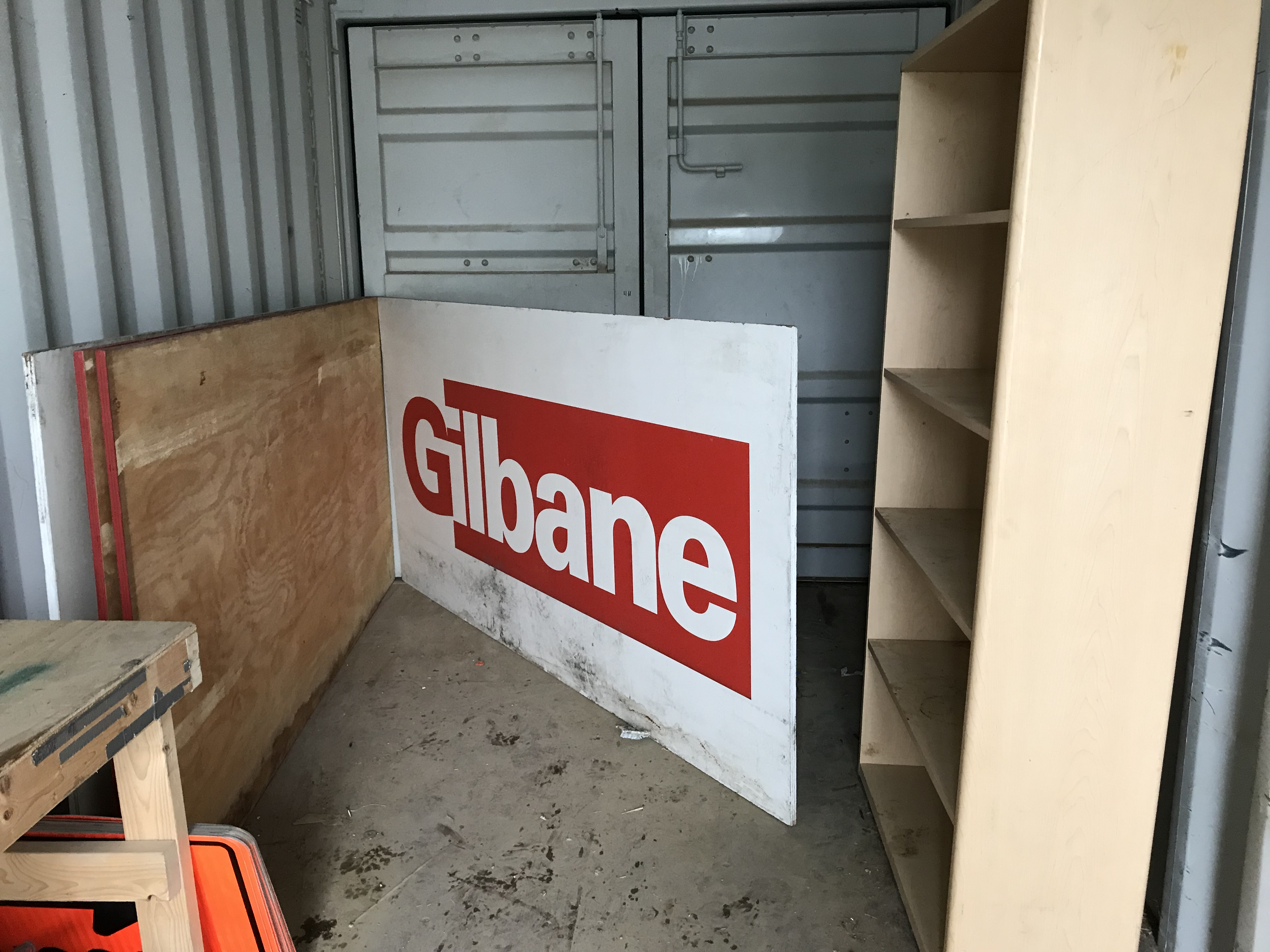 Gilbane logo sign on plywood, 4ft x 8ft x 3/4″; Qty: 2.