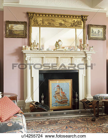 Stock Photo of Ornate gilt mirror above neo.