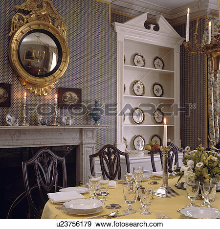 Stock Photography of Ornate gilt antique convex mirror on wall of.