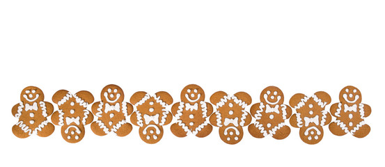 A row of Gingerbread Men cookies isolated on white background border.