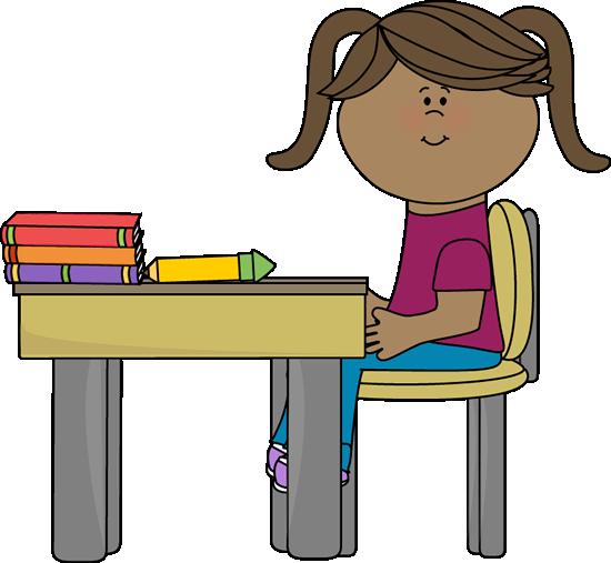 School Girl Sitting at a Desk.