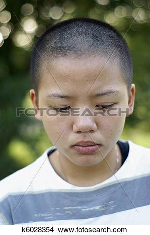 Stock Photo of Sad asian teen girl with shaved head k6028354.