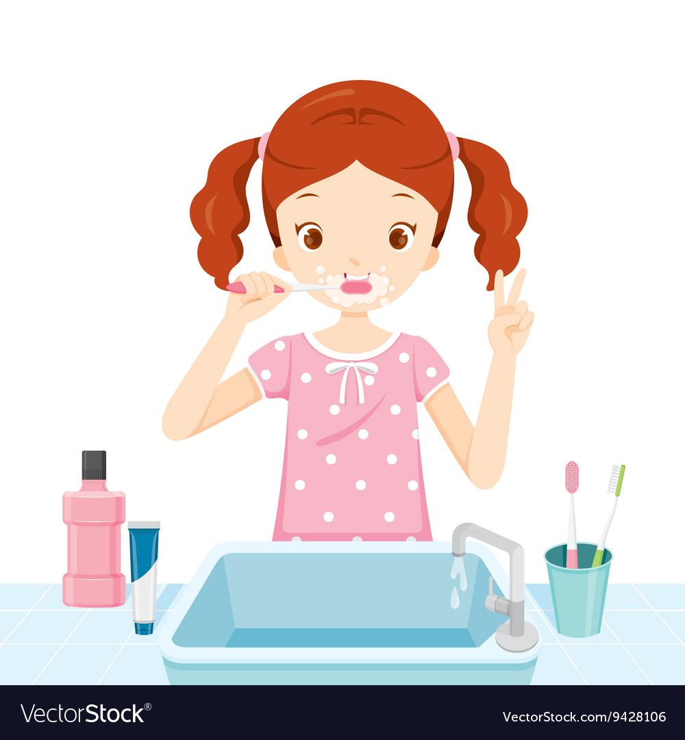 Girl In Pyjamas Brushing Her Teeth In Bathroom.
