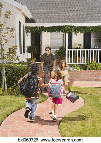 Stock Images of Hispanic parents greeting children coming home.