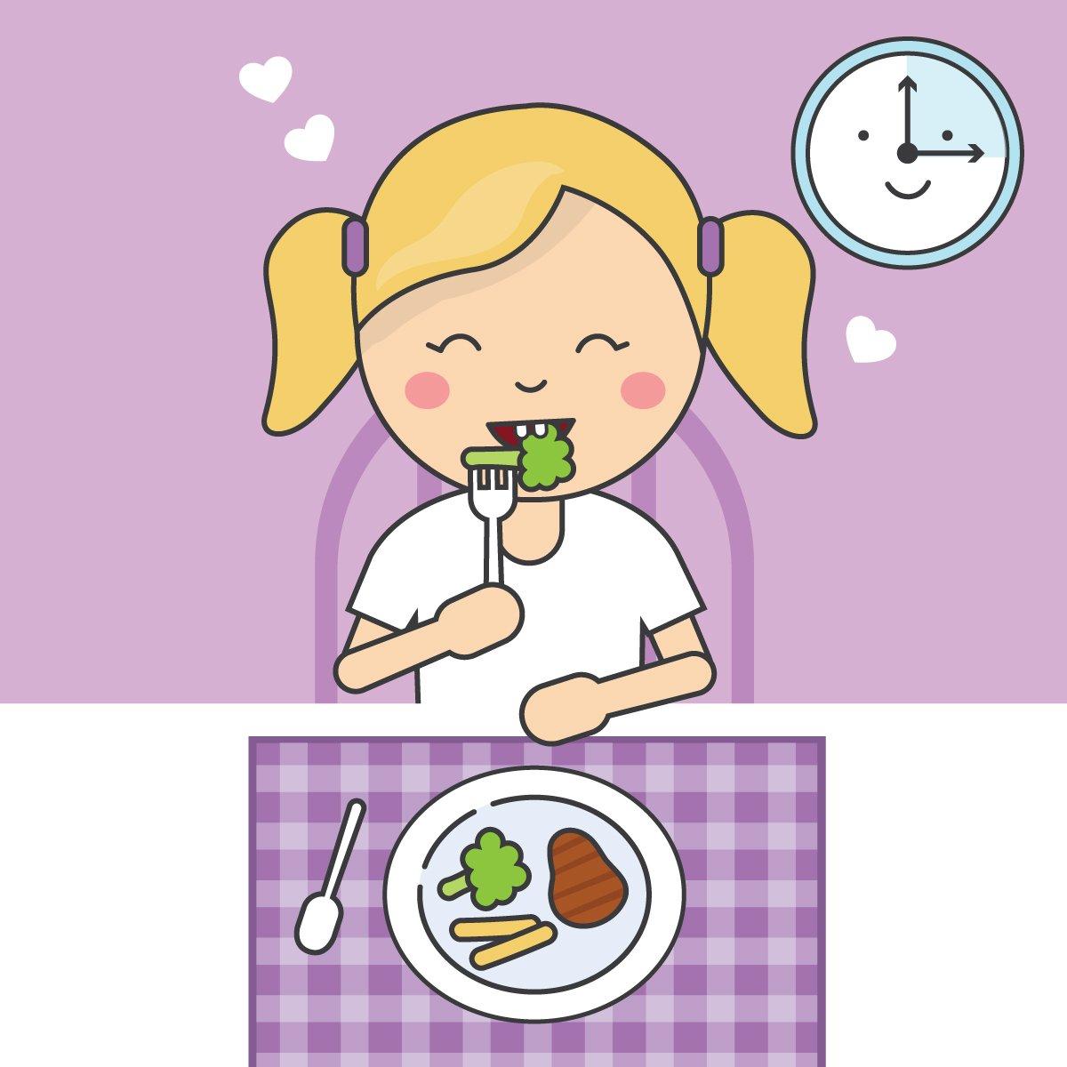 Cute girl eating dinner.