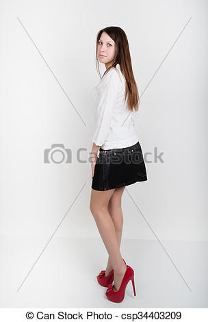 Stock Photography of Beautiful slim girl in a short black skirt.