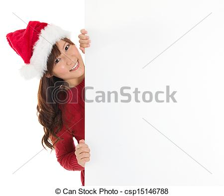 Pictures of Cute Santa girl peeking from behind blank sign.