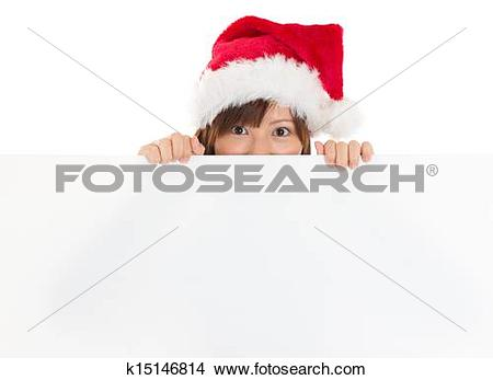 Stock Photo of Asian girl in Santa peeking over paper sign board.