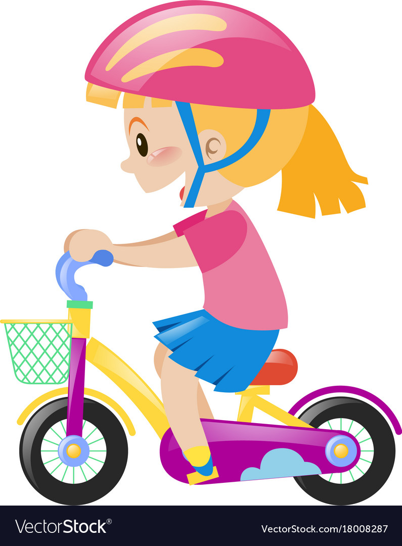 Little girl wearing pink helmet riding bike.
