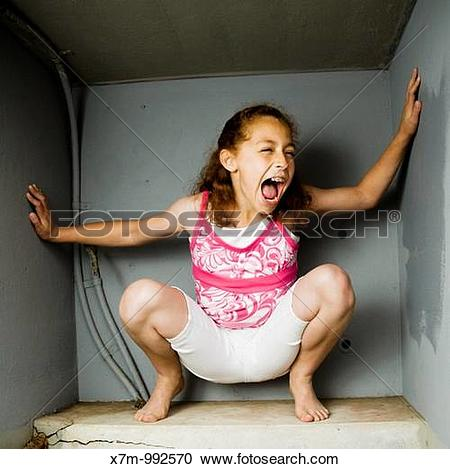 Stock Photography of A mixed race girl Mexican & caucasian trapped.