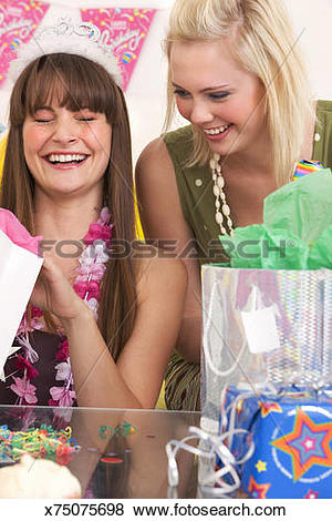 Pictures of Two girls unwrapping birthday presents, Cape Town.