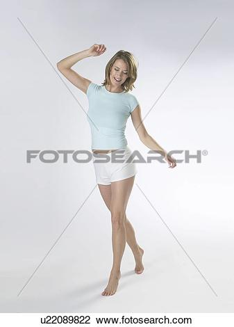 Stock Photo of Woman wearing white shorts and a t.