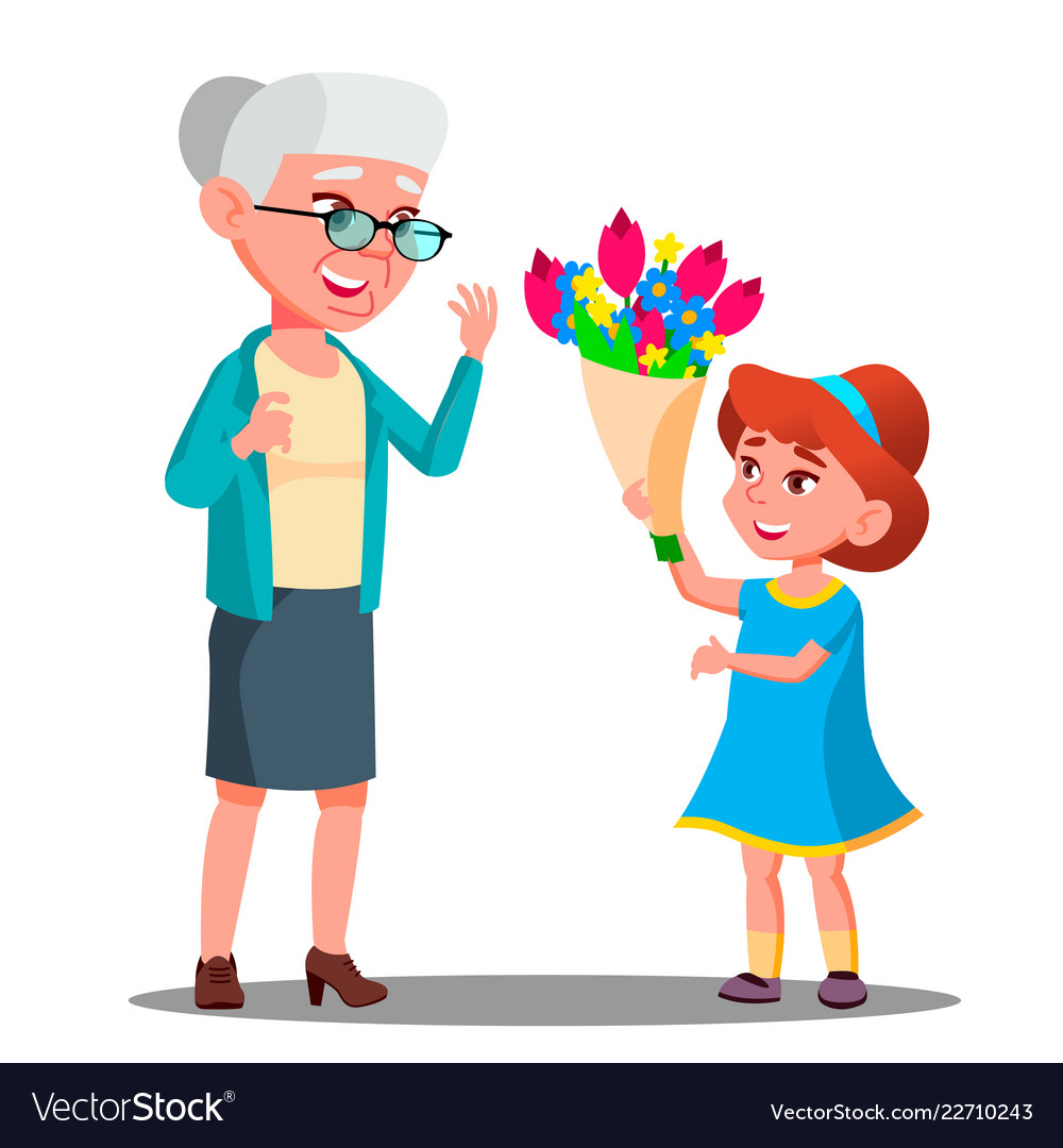 Little girl giving flowers to grandmother.