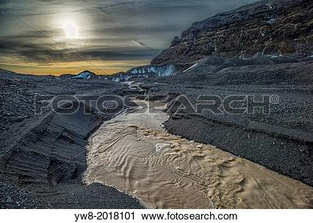 Stock Photography of River bed, and moraines, Fallsjokull Glacier.