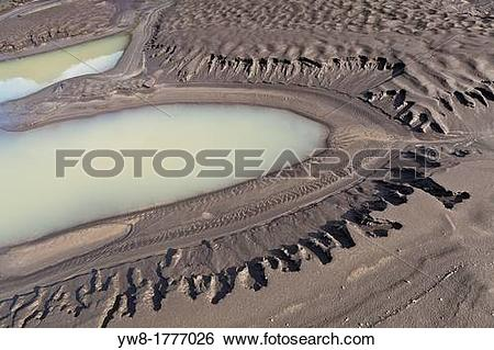 Stock Images of River bed, and mud flats with ash from volcanic.