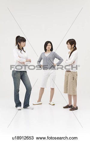 Stock Photo of Three young women glaring at each other u18912653.
