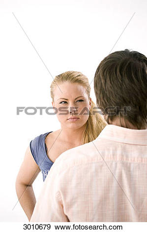 Stock Photograph of A Young woman glaring at man, over the.
