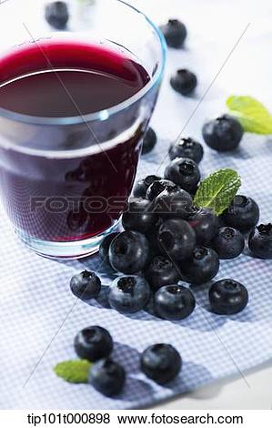 Pictures of glass of berry juice with blue berries tip101t000898.